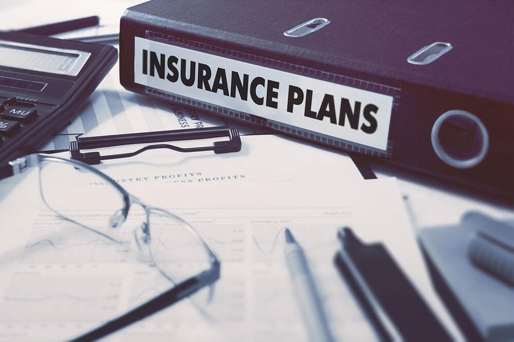 Insurance Plans - Ring Binder on Office Desktop with Office Supplies. Business Concept on Blurred Background. Toned Illustration.